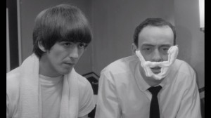 George gives road manager Shake (John Junkin) a 'shave' in A Hard Day's Night