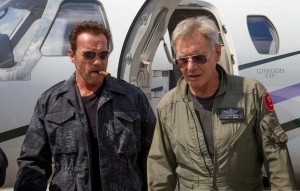 Arnold Schwarzenegger with trademark cigar as Trench Mauser opposite Harrison Ford's CIA operative Max Drummer in The Expendables 3