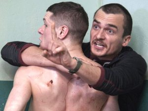 Therapist Oliver Baumer (Rupert Friend) tries to help inmate Eric (Jack O'Connell) in Starred Up