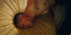 Convict Eric Love (Jack O'Connell) won't take things lying down in Starred Up