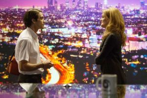 The city of nightmares... Lou Bloom (Jake Gyllenhaal) and cable TV news director Nina (Rene Russo) in Nightcrawler