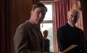 Alan Turing (Benedict Cumberbatch  butts heads with Cdr. Alastair Denniston (Charles Dance) while Maj. Gen. Stewart Menzies (Mark Strong) looks on in The Imitation Game