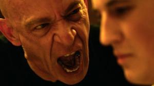 Fletcher (J.K Simmons) opens up a can of whupass on Andrew (Miles Teller) in Whiplash