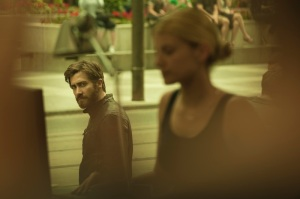 Anthony (or is it Adam?) (Jake Gyllenhaal)  spies on Mary (Mélanie Laurent) in Enemy