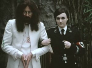 Ron Nasty (Neil Innes) and partner Chastity (Gwen Taylor), aka Yoko Ono in The Rutles