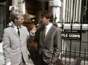 Ex-Beatle George Harrison interviews Rutle Corp press agent Eric Manchester (Michael Palin) in The Rutles