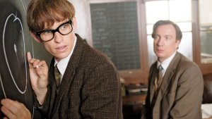 Stephen Hawking (Eddie Redmayne) makes a breakthrough in front of lecturer Dennis Sciama (David Thewlis) in The Theory Of Everything