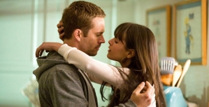 Brian (Paul Walker) and Mia (Jordana Brewster) in Fast And Furious 7