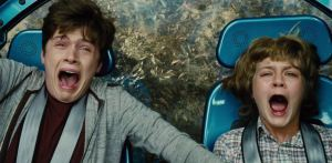 Brothers Zach (Nick Robinson) and Gray Mitchell (Ty Simpkins) look suitably scared in Jurassic World
