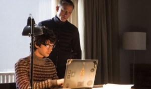 Bond (Daniel Craig) and Q (Ben Wishaw) check out a pirated copy of Spectre in... Spectre
