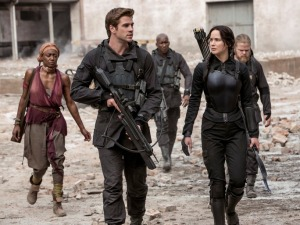 Katniss (Jennifer Lawrence) and Gale (Liam Hemsworth) lead the resistance in The Hunger Games: Mockingjay - Part 2