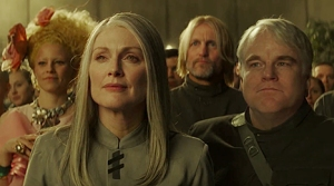 President Coin (Julianne More) and Plutarch (Philip Seymour Hoffman) take command in The Hunger Games: Mockingjay - Part 2