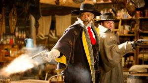"Gun-toting ""Bounty Hunter"" (Samuel L. Jackson) and ""The Sheriff"" (Walton Goggins) in The Hateful Eight"