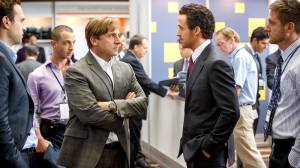 Outspoken Wall Street hedge fund manager Mark Baum (Steve Carell) tries to keep himself in check in front of suave hot shot Jared Vennett (Ryan Gosling) in The Big Short