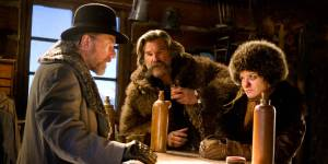 """The Little Man"" (Tim Roth) questions ""The Hangman"" (Kurt Russell) and ""The Prisoner"" (Jennifer Jason Leigh) in The Hateful Eight"